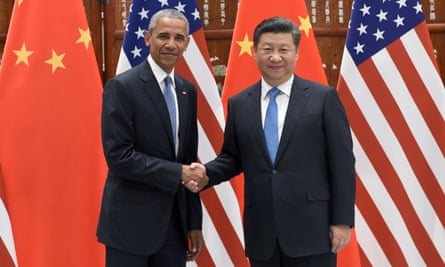 Barack Obama and Xi Jinping shake hands before the G20 summit.