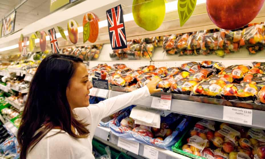 Young woman shopping in Waitrose supermarket