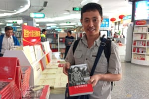 Wu Huifeng, 43, studies a new book about Xi Jinping's youth at a bookshop in Beijing, China.