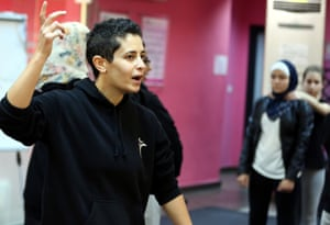 Lina Khalifa, founder of SheFighter, talks to students at the studio in Amman.