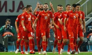 Macedonia's Goran Pandev celebrates scoring their third goal with his teammates.