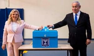 Benjamin Netanyahu and his wife Sara Netanyahu vote in Jerusalem.