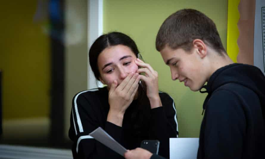 A pupil at King David high school in Liverpool reacts with relief after receiving her GCSE exam results.