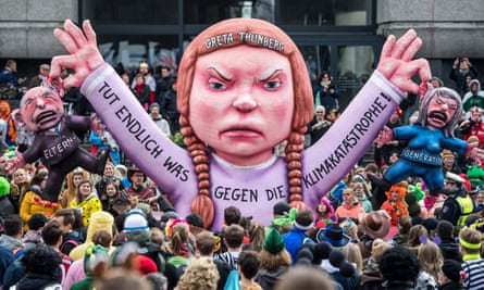 ABOVE Greta Thunberg to parent' generation: 'Do something, finally, to combat the climate catastrophe!' - effigy of Greta in Dusseldorf in March 2019. The figures the model is holding represent the 'parents' generation'.