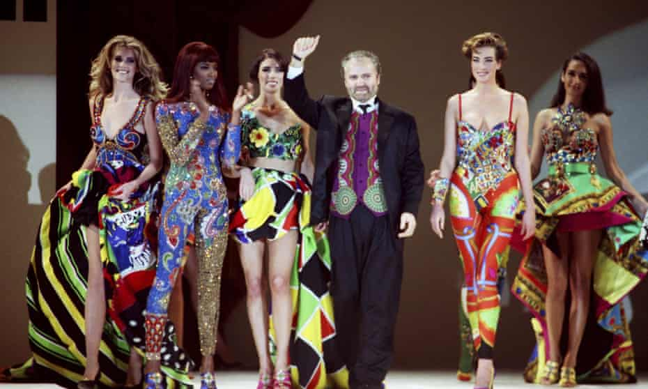 Gianni Versace takes a bow at a 1991 show in Los Angeles.
