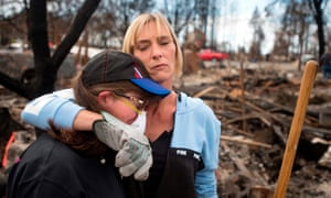 Neighbours in the Coffey Park area of Santa Rosa, California. A city councilwoman said 15,000 people had lost their homes.