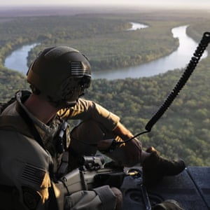 A US Customs and Border Protection agent searches for undocumented immigrants during a helicopter patrol over the Rio Grande at the US-Mexico