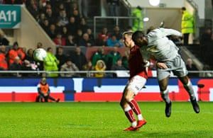 Lukaku heads at goal.