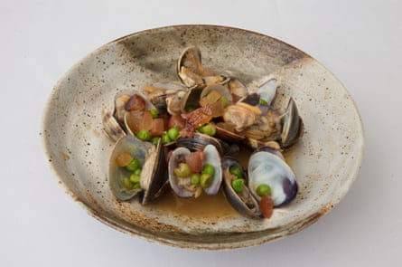 Clams cooked with guanciale, fresh peas and fino, at Flora restaurant, London.