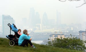 Mother and child in Greenwich park, with heavily polluted London beyond