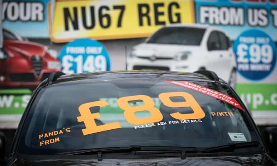 Finance options are displayed on new cars at a dealership in Bristol