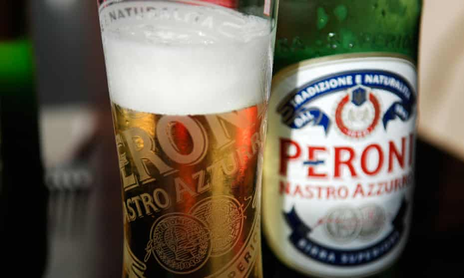 Glass of Peroni Italian lager next to a bottle