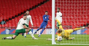 England's Jadon Sancho (centre) scores his side's second goal of the game.