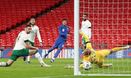 Jadon Sancho guides a precision finish past Darren Randolph to put England 2-0 up as Republic of Ireland defenders watch on helplessly.
