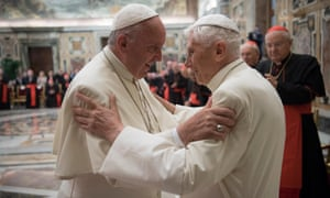 Pope Francis, left, and retired Pope Benedict XVI embrace during a ceremony to celebrate Benedict's 65th anniversary of his ordination as a priest, in the Clementine Hall of the Apostolic Palace, at the Vatican.