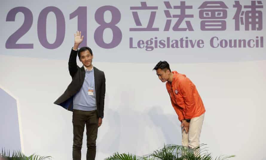 Hong Kong pro-Beijing by-election candidate Vincent Cheng Wing-shun bows to his pro-democracy by-election rival Edward Yiu. Wing-shun wo a seat at the legislative council by-elections in Hong Kong.