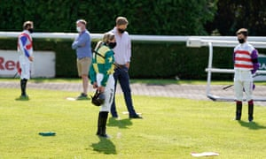 Jockeys and connections hold a minutes silence in memory of Liam Treadwell, at Kempton Park on 23 June.