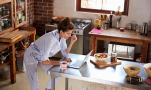 Woman working from home in her pyjamas
