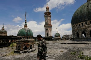 A soldier walks on the rooftop of the war-torn Grand Mosque of Marawi City, Philippines