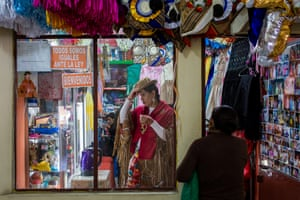 Diana Málaga prepares to leave her clothing shop in La Paz
