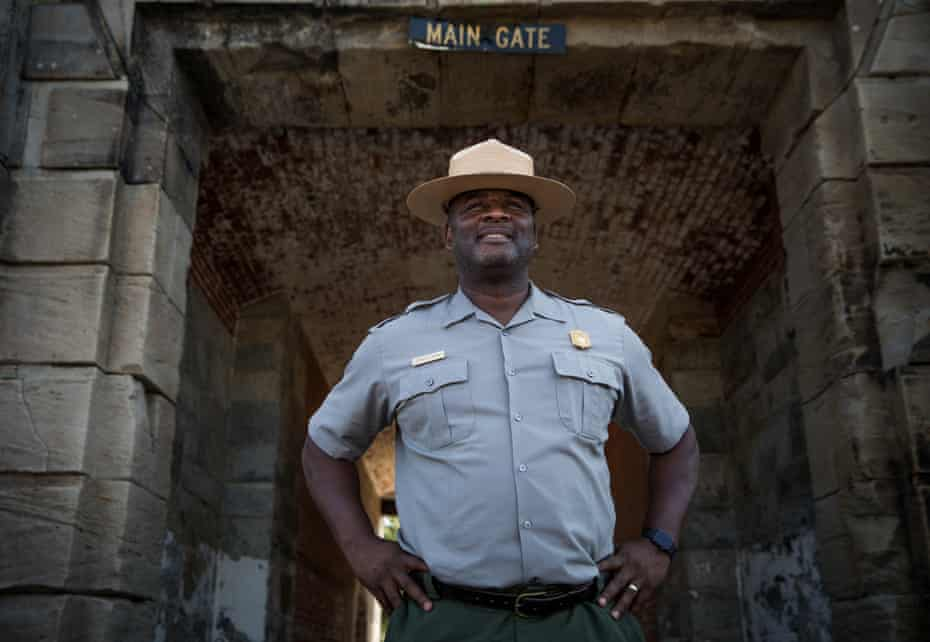 Terry Brown stands at the gate at Fort Monroe where the first move towards emancipation occurred when enslaved men Frank Baker, James Townsend and Shepard Mallory sought sanctuary during the civil war.