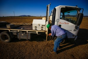 Tydd washes his hands next to his truck after working on the windmill