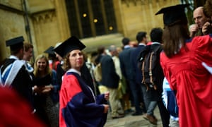 Graduates gather after a graduation ceremony at Oxford University: the industrial action may disrupt this summer's undergraduate exams.