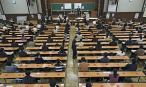 Candidates practice social distancing as they attend the annual unified college entrance examinations at the University of Tokyo.