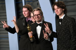 Gary Oldman arrives at the Vanity Fair party with his wife Gisele Schmidt and sons Gulliver Oldman (right) and Charlie Oldman (left)