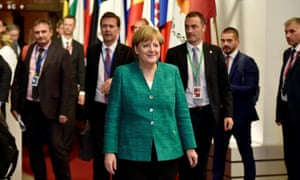 The German chancellor, Angela Merkel, leaves the EU leaders' summit in Brussels