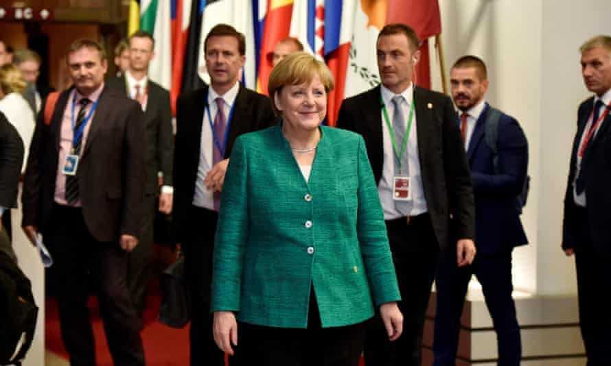 The German chancellor, Angela Merkel, leaves the EU leaders' summit in Brussels