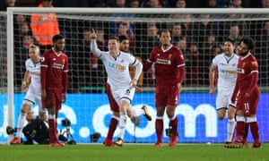 Alfie Mawson celebrates after scoring the opening goal for Swansea. It proved to be the winner as Liverpool could not find a way through.