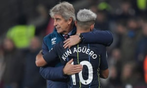 Sergio Agüero embraces his former coach, Manuel Pellegrini, after leaving for Manchester City.