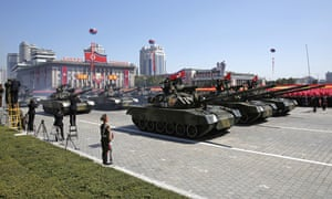 North Korean tanks roll past during a parade for North Korea's 70th anniversary.