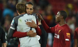 Liverpool's Virgil van Dijk greets Norwich City's goalkeeper Tim Krul after the final whistle.