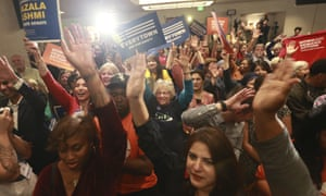 Democratic supporters cheer their candidates at a Democratic Party victory celebration in Richmond, Va., Tuesday, Nov. 5, 2019. All seats in the Virginia House of Delegates and state Senate are up for election. (AP Photo/Steve Helber)