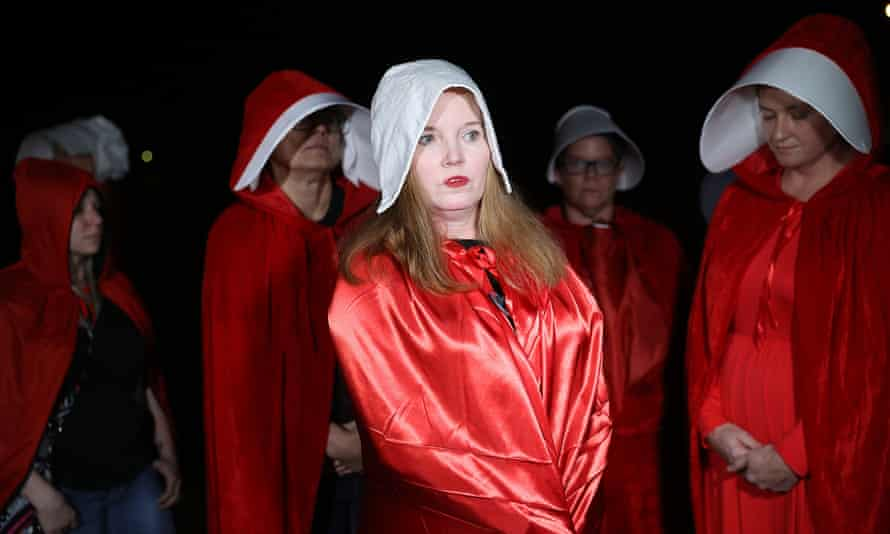 Protesters dressed as handmaids at a Roy Moore rally