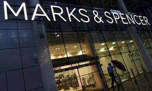Man leaving Marks & Spencer's branch