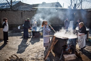 Women cooking Sumalyak, a traditional springtime dish in Osh, Osh Oblast. 'Father comes tomorrow' is a phrase familiar to millions of children across central Asia, though no one knows when 'tomorrow' will actually come