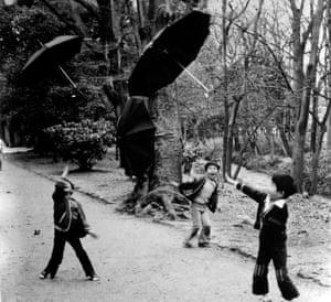 Throwing umbrellas. 1978