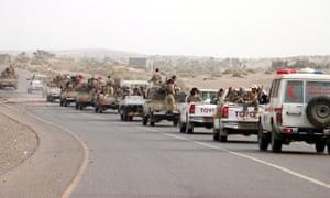 Yemeni forces backed by the Saudi-led coalition gather near the outskirts of Hodeidah.