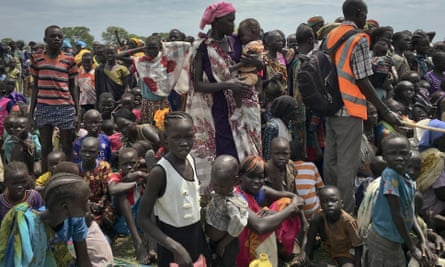 People queue as food is distributed in Old Fangak, in South Sudan's Jonglei state