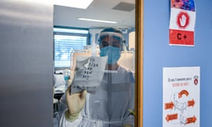 A healthcare worker looks for a paper with notes on the door of a patient's room in the Covid-19 intensive care unit (ICU) at Hospital Universitario de São João, on February 11, 2021 in Porto, Portugal.