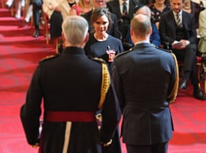 London, England Victoria Beckham receives an OBE from the Duke of Cambridge during an investiture ceremony at Buckingham Palace