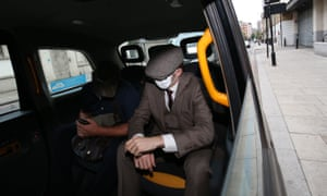 London, England: A Met police officer leaves Westminster magistrates court