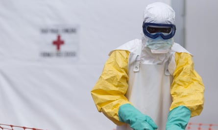 A health worker is seen at an Ebola treatment centre run by the Red Cross society in Guinea during the 2014 Ebola outbreak