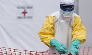 A health worker at an Ebola treatment centre in Guinea.