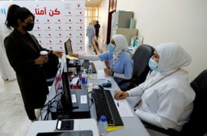 A woman takes her appointment for a second dose of a coronavirus vaccine, at Bahrain International Exhibition & Convention Centre (BIECC), in Manama, Bahrain on 24 December, 2020.