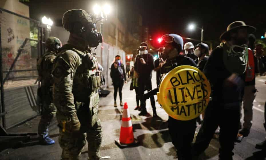 Federal police confront protesters in downtown Portland, Oregon.