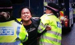 Tibetan activist Sonam Choden, 31, is arrested by Metropolitan police officers.